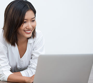 A girl looking at her laptop